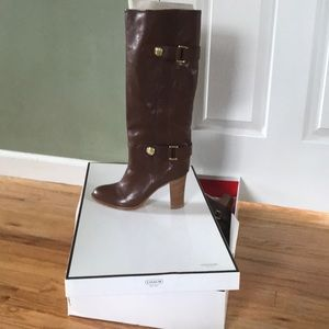 Size 8 leather Coach boots with a gold button.